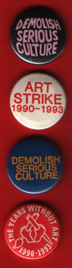 badges promoting the Art Strike